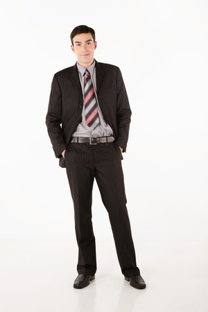 Businessman with hands in the pockets photo
