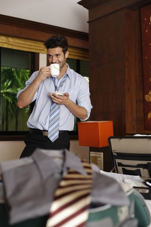 southeastern european descent: Businessman drinking a cup of coffee