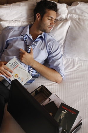 Businessman sleeping after reading