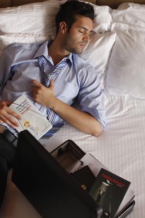 tired businessman: Businessman sleeping after reading