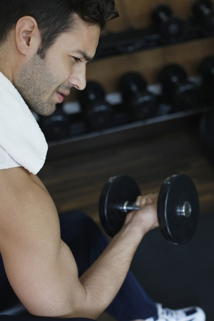 southeastern european descent: Man lifting weights Stock Photo