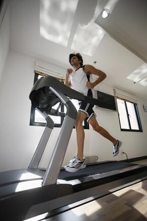 Man running on treadmill Stock Photo - 13366615