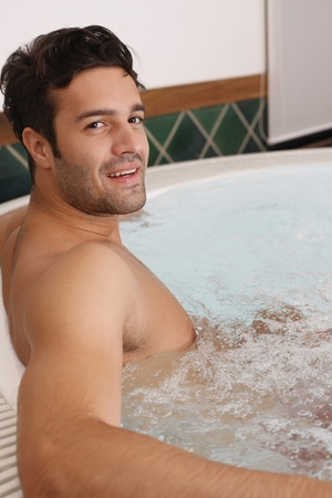Man relaxing in hot tub photo