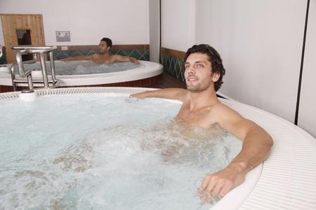 southeastern european descent: Men relaxing in hot tub