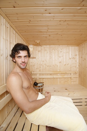 southeastern european descent: Man relaxing in sauna Stock Photo
