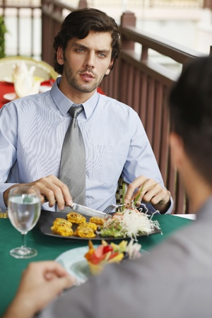 Businessmen having lunch at a restaurant photo
