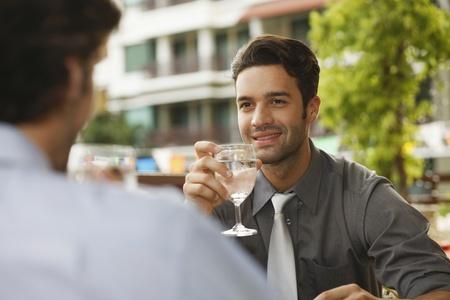 southeastern european descent: Businessmen drinking water