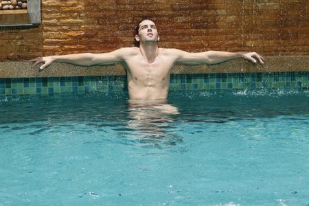 Man relaxing in the pool photo