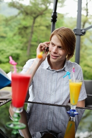 Man smiling while talking on the phone Stock Photo - 13378153
