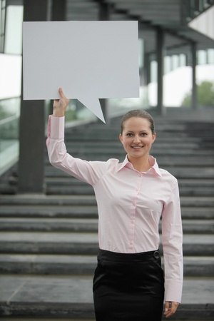 Businesswoman with a speech bubble photo