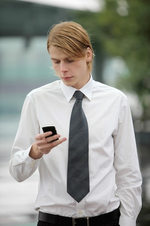 Businessman text messaging on the phone photo
