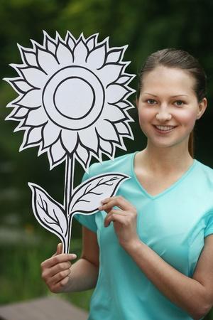 cardboard cutout: Woman holding sunflower