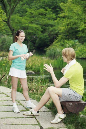Man and woman chatting in the park Stock Photo - 13378720