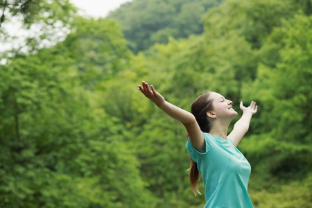 Woman with arms outstretched and eyes closed Stock Photo - 13378185