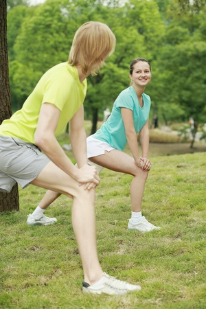 Man and woman exercising in the park Stock Photo - 13378630