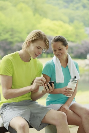 Man and woman looking at mobile phone photo