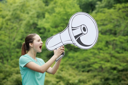 Woman speaking through megaphone Stock Photo - 13378384