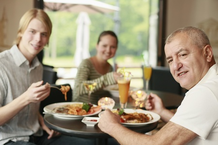 italian ethnicity: Men and woman having lunch together