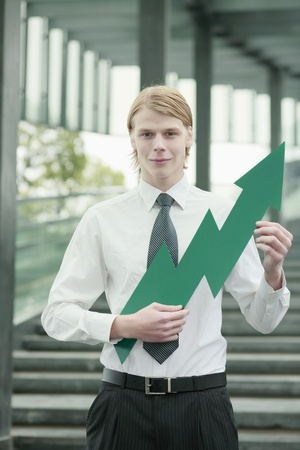 Businessman with an up pointing arrow photo
