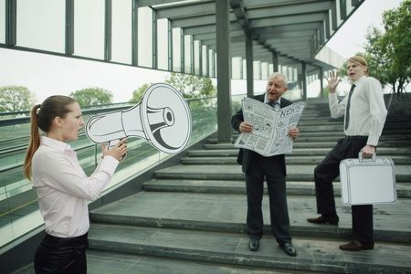Businesswoman speaking through megaphone photo