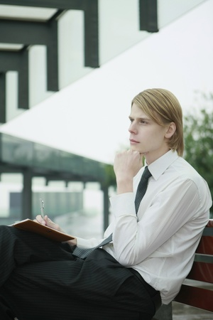 Businessman in deep thought photo