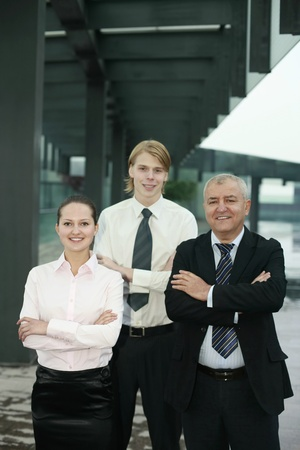 Business people with their arms folded photo