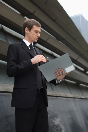 Businessman reading documents in file photo