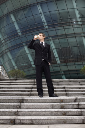 Businessman drinking a cup of coffee photo