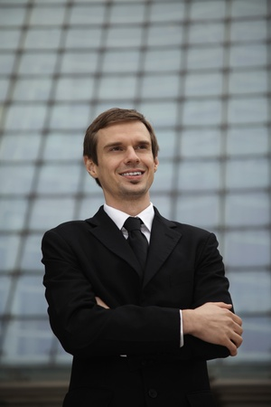 Businessman with arms crossed smiling photo