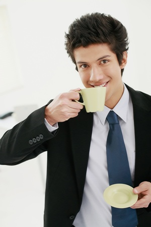 Businessman enjoying a cup of coffee Stock Photo - 13383776