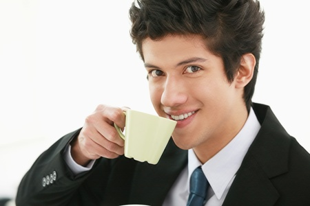 Businessman enjoying a cup of coffee Stock Photo - 13383808
