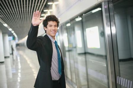 Businessman on platform waiting for train Stock Photo - 13384143