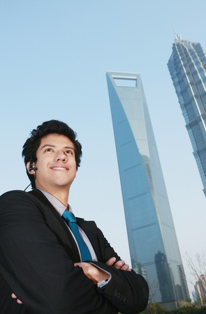 Businessman with arms crossed looking ahead photo