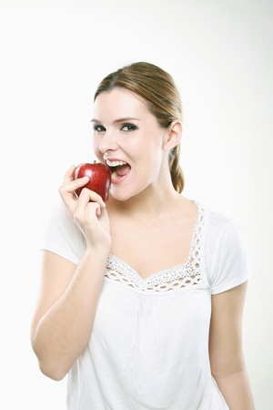 Woman eating an apple Stock Photo - 13384153