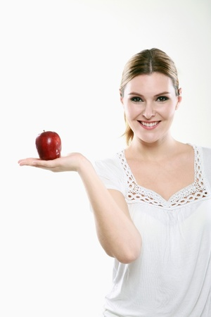 Woman holding an apple Stock Photo - 13384009