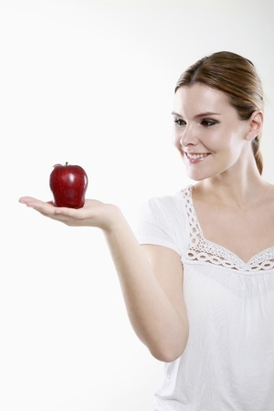 Woman holding an apple Stock Photo - 13384077