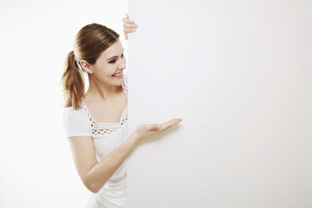Woman showing a blank placard Stock Photo - 13384025