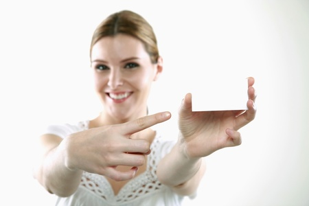 Woman pointing at business card Stock Photo - 13383968