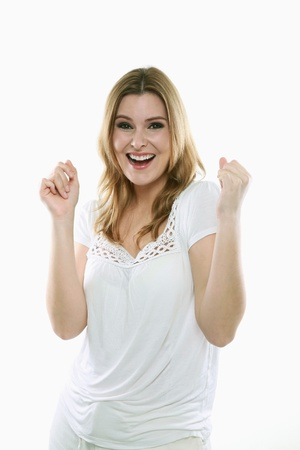 Woman cheering and raising arms Stock Photo - 13384020