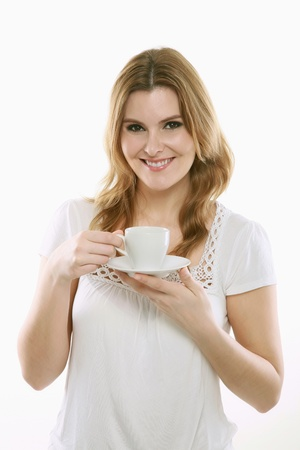 Woman enjoying a cup of coffee Stock Photo - 13384145