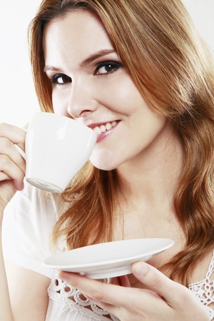 Woman enjoying a cup of coffee photo
