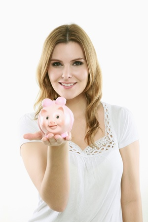 Woman holding a piggy bank photo