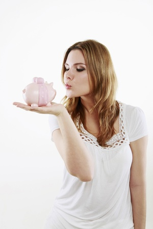 Woman about to kiss piggy bank Stock Photo - 13384118