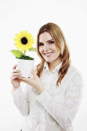 Businesswoman holding sunflower in a pot photo