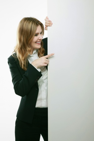 Businesswoman standing behind blank placard Stock Photo - 13384039