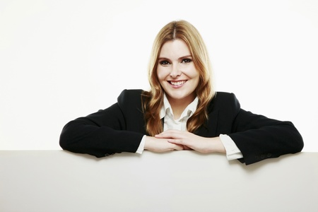 Businesswoman with both arms resting on blank placard Stock Photo - 13383997