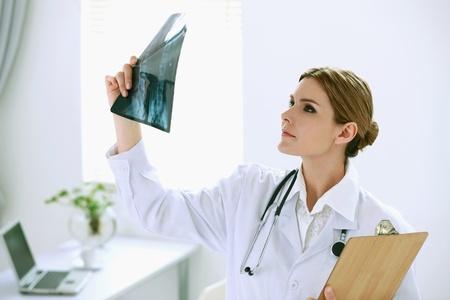 Doctor examining x-ray film photo