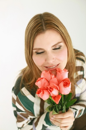 Woman smelling roses photo