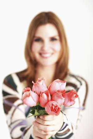 Woman holding roses Stock Photo - 13384002