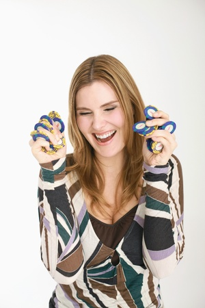 Woman holding gambling chips photo